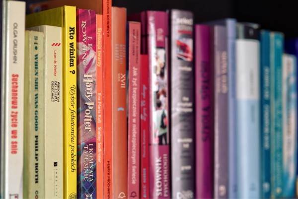 row of colorful books on shelf